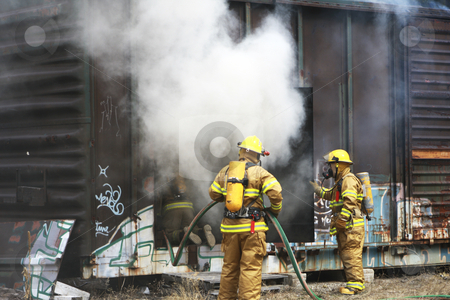 373 Firemen working to put out fire stock photo, Firemen putting out a fire in a railway car by Sharron Schiefelbein