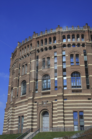 361 Gasometer in Vienna stock photo, These round shaped buildings built in 1899 were used as to store gas.  There are new buildings inside the old ones. by Sharron Schiefelbein