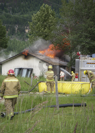 House Fire stock photo, Fire Department fighting house fire by Sharron Schiefelbein