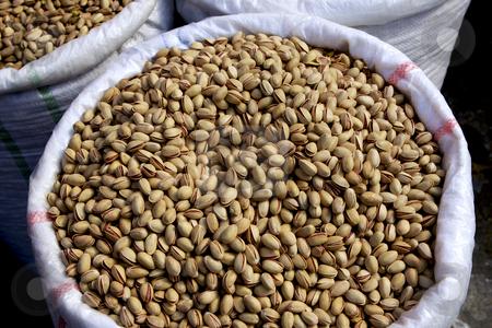 351 Pistachio Nuts stock photo, Pistachio, nuts, bag, market, food, bulk, fruit, Mediterranean, Anacardiacea, green, brown by Sharron Schiefelbein
