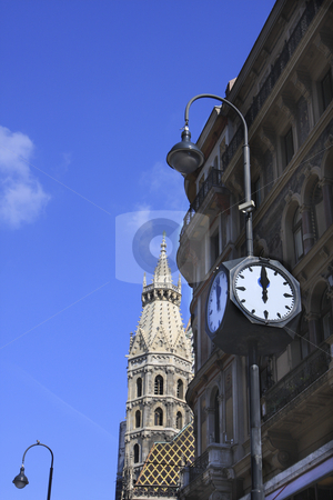 359 Clock in Stephansdom Plaza stock photo, View of Stephansdom Plaza with the Romanesque church in the background by Sharron Schiefelbein