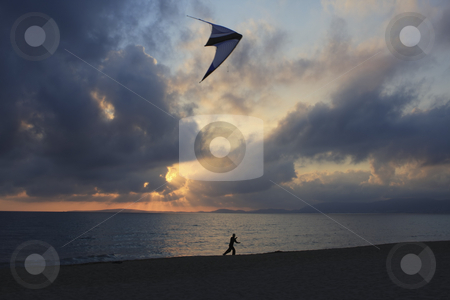 Flying a kite at sunset stock photo, Kite flying in Mallorca Spain at sunset by Sharron Schiefelbein