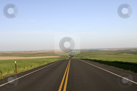 Montana Road stock photo, Montana highway with fields on both sides by Sharron Schiefelbein