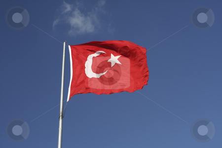 Turkish Flag stock photo, Against the blue sky flies  the red and white Turkish flag by Sharron Schiefelbein