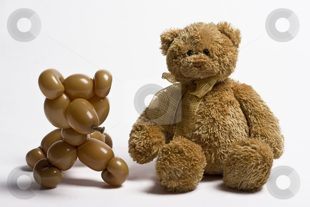 Same difference stock photo, Brown balloon bear and teddy bear sitting side by side by Yann Poirier