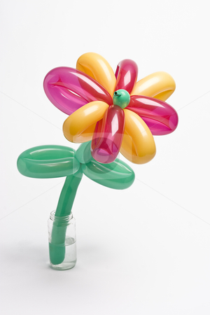 Balloon flower stock photo, Balloon flower with pink and yellow balloon for petals and green balloon for stem and leaves by Yann Poirier