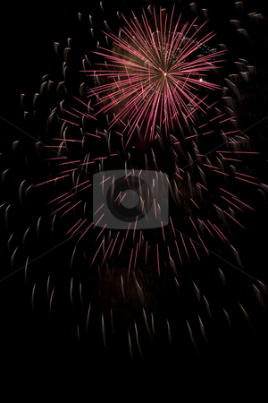 Firework stock photo, Short burst of a red firework display trailing in the wind by Yann Poirier