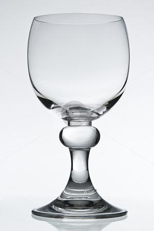Wine Glass stock photo, Empty wine glass on white background by Yann Poirier