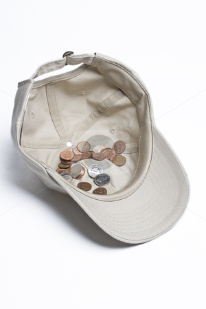 Begging for change stock photo, Baseball cap with some canadian change in it by Yann Poirier