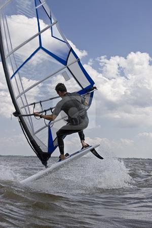 Windsurfer flipping stock photo, Windsurfer doing a flip trick in the water by Yann Poirier