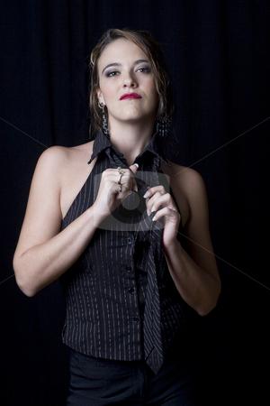Taking off tie stock photo, Sexy business women taking off tie by Yann Poirier