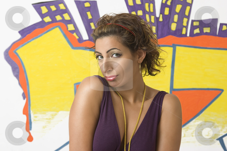Shy women stock photo, Young women with shy behavior in front of graffiti by Yann Poirier