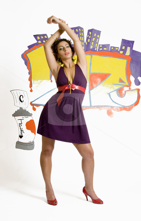 Street fashion stock photo, Fashion model posing in front of a graffiti by Yann Poirier