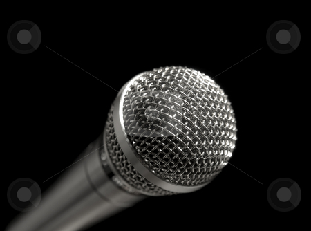 Microphone over black stock photo, A dynamic microphone over a black background. by Ignacio Gonzalez Prado