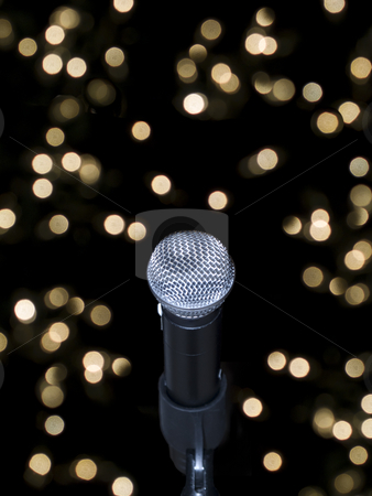 Microphone on stage stock photo, A microphone alone on stage full of out of focus lights. by Ignacio Gonzalez Prado
