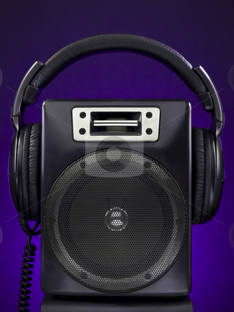 Speaker and headphone set stock photo, A speaker and a headphone set over a purple background. by Ignacio Gonzalez Prado