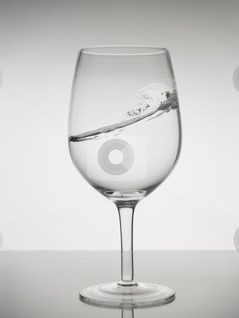 Surfing in a glass stock photo, A water wave into a wine glass. by Ignacio Gonzalez Prado