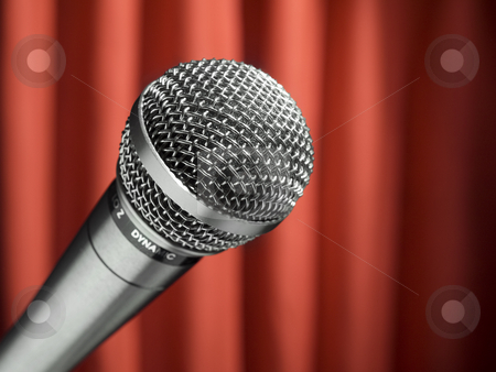 Mic on stage stock photo, A dynamic microphone over a red background. by Ignacio Gonzalez Prado