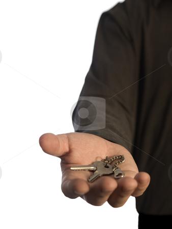 Man holding keys stock photo, A man holding a pair of keys on his hand over a white background. by Ignacio Gonzalez Prado