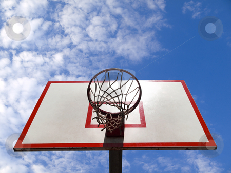 Basketball ring stock photo, A basketball ring over a blue sky with clouds. by Ignacio Gonzalez Prado