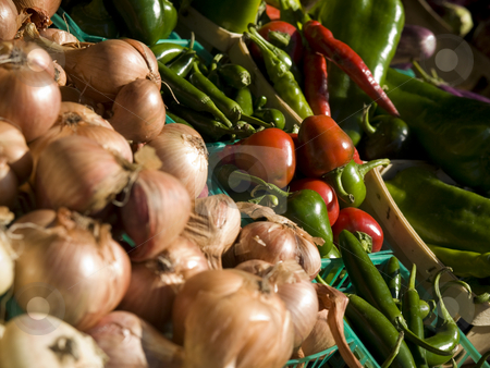 Market groceries stock photo, Onions, red peppers and green peppers in blue baskets. by Ignacio Gonzalez Prado