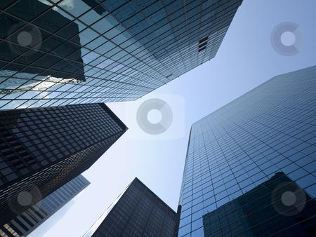 New York buildings stock photo, High modern skyscrapers on a background of a bright sky. by Ignacio Gonzalez Prado