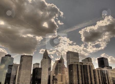 Cloudy cityscape stock photo, A cityscape picture in a cloudy day. by Ignacio Gonzalez Prado