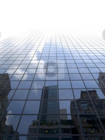 Sky scraper stock photo, High modern skyscraper on a background of a bright sky. by Ignacio Gonzalez Prado