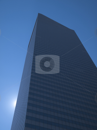New York building stock photo, High modern skyscraper on a background of a blue sky and the sun. by Ignacio Gonzalez Prado