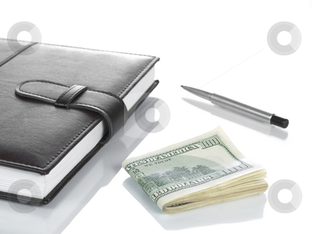 Booknote, dollars and a pen. stock photo, A booknote with several hundred dollar bills and a pen, isolated on white. by Ignacio Gonzalez Prado