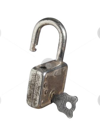 Lock and key stock photo, An open lock with a key isolated on white background. by Ignacio Gonzalez Prado