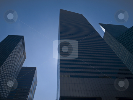 New York buildings stock photo, High modern skyscrapers on a background of a blue sky. by Ignacio Gonzalez Prado
