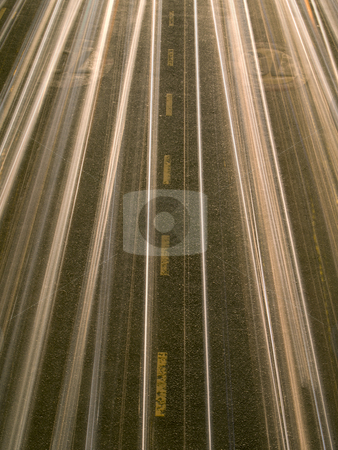 Night lights stock photo, Motion blur in a busy road at night. by Ignacio Gonzalez Prado