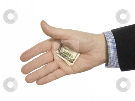 Hidden tip stock photo, A man's hand hiding a hundred dollars tip. by Ignacio Gonzalez Prado