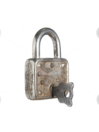 Lock and key stock photo, A closed lock with a key isolated on white background. by Ignacio Gonzalez Prado