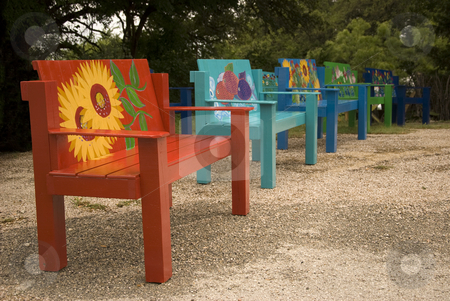 Home Made Benches stock photo, Bright and colorful hand crafted benches displayed for sale. by Charles Buegeler