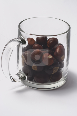 Nuts in a glass stock photo, Glass filled with wild nuts by Yann Poirier