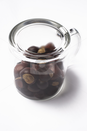 Upside down stock photo, Upside down cup fill with chestnut by Yann Poirier