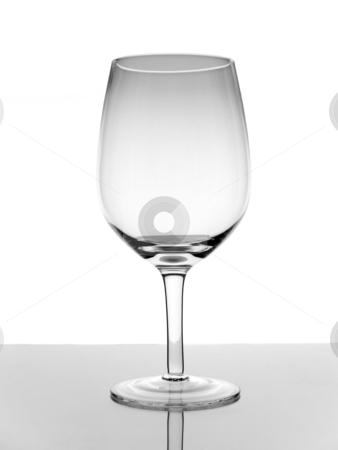 Empty glass of wine stock photo, A shot of an empty glass wine with reflection on white background. by Ignacio Gonzalez Prado