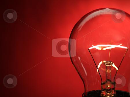 Bulb light stock photo, A bulb light on red background by Ignacio Gonzalez Prado