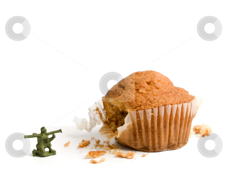 Burning calories! stock photo, A little toy soldier shooting his bazooka at a muffin. A conceptual image about the importance of a haelthy lifestile. by Ignacio Gonzalez Prado