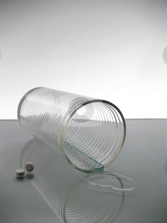 Glass of water stock photo, A felt glass of water with two pills. by Ignacio Gonzalez Prado