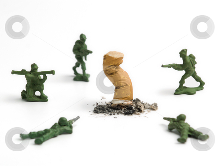 Kill it! stock photo, A cigarette butt been killed by a group of toy soldiers. by Ignacio Gonzalez Prado