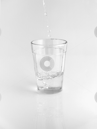 Glass of water stock photo, Pouring water in a glass. by Ignacio Gonzalez Prado