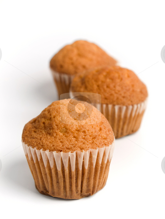 Three muffins stock photo, Three muffins over white background. by Ignacio Gonzalez Prado