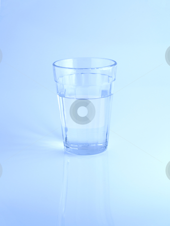 Glass of water stock photo, A glass of water on blue background. by Ignacio Gonzalez Prado