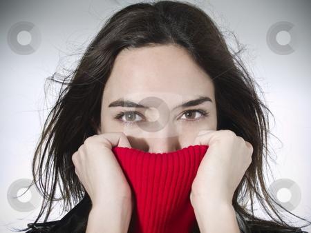 Sexy girl stock photo, Portrait of a beautiful model holding her red sweater neck. by Ignacio Gonzalez Prado