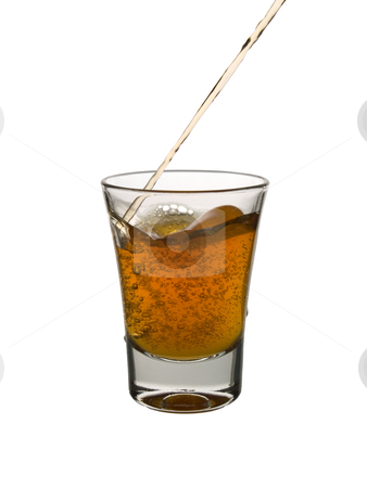 Shot of whisky stock photo, Pouring a shot of whisky on white background. by Ignacio Gonzalez Prado