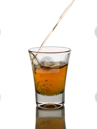 Shot of whisky stock photo, Pouring a shot of whisky. by Ignacio Gonzalez Prado