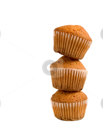 Pile of muffins stock photo, A pile of three muffins isolated over white background. by Ignacio Gonzalez Prado